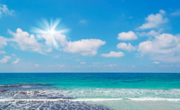 Shining sun and blue water Royalty Free Stock Photography