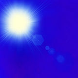 Shining sun at clear blue sky with copy space Stock Image