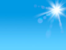 Shining sun at clear blue sky with copy space.  Royalty Free Stock Image