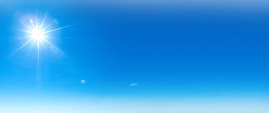 Shining sun at clear blue sky stock images