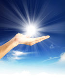 Shining sun at clear blue sky with copy space Royalty Free Stock Photos