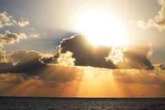 Shining sun and dark clouds Royalty Free Stock Photo