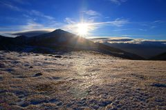 Shining sun over a Snowy mountain in Pyrenean,  France royalty free stock images