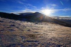 Shining sun over a Snowy mountain in Pyrenean,  France stock photography