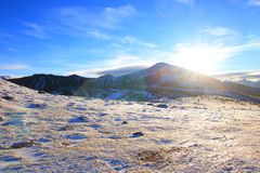 Shining sun over a Snowy mountain in Pyrenean,  France stock image