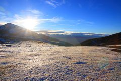 Shining sun over a Snowy mountain in Pyrenean,  France royalty free stock image
