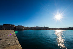 Shining sun on the sea in front of Piazza Unità, Trieste Stock Photography