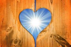 Shining sun in a wooden heart Stock Photos