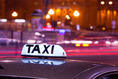 Shining Taxi inscription Royalty Free Stock Photos