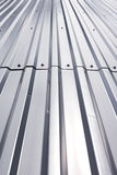 Shining texture of corrugated industrial metal roof Stock Photography