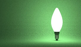 Shining torpedo light bulb on green Stock Image