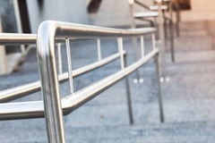 Shining urban metal handrails on a stairway stock image