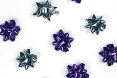 Shining violet and silver Christmas ornament on white background. Christmas ornament of several violet and silver shiny decorations on white background royalty free stock images