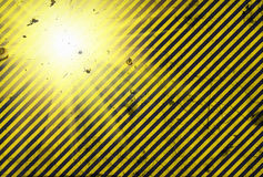 Shining warning black and yellow diagonal lines in grunge style Royalty Free Stock Photos