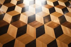 Shining wooden parquet flooring design. With volume cubes illusion. Background photo Royalty Free Stock Photography