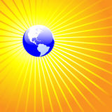 Shining World Earth AMERICAS. Blue Earth Globe Radiant: A shining world on a background of bright yellow gold rays stock illustration