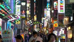 Shinjuku at dusk with neon & traffic stock video footage