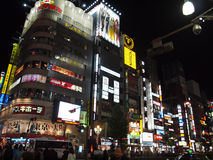 Shinjuku Night Scene. Colourful Neon Lights Advertisement Signages along Shinjuku, Tokyo, Japan Stock Photos