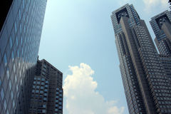 Shinjuku skyscrapers and blue sky and trees Stock Images