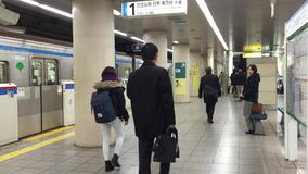 Shinjuku Station in Tokyo. People walk at Shinjuku Station in Tokyo. It is the world's busiest transport hub with daily usage by up to 3.64 million people stock video