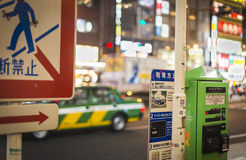 Shinjuku Street. Cabs drive by on a busy street in Shinjuku in Tokyo, Japan Royalty Free Stock Photos