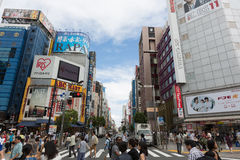 Shinjuku in Tokyo, Japan. People walk past the Shinjuku ward in Tokyo, Japan. Shinjuku is the large entertainment, business and shopping area in Japan Royalty Free Stock Photos