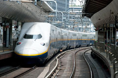 Shinkansen bullet train. Tokyo, Japan - May 17, 2012: Shinkansen bullet train at Tokyo main railway station in May 2012 Tokyo, Japan.The Shinkansen is the world' Royalty Free Stock Photography