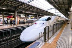 Shinkansen bullet train at JR Kyoto Station. Shinkansen bullet train model 700 Series, at railway platform JR Kyoto Station. Japan Stock Image