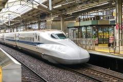 Shinkansen bullet train in Kyoto rail station, Japan. KYOTO, JAPAN - DECEMBER 04, 2014: A Shinkansen Bullet Train December 04, 2014 in Kyoto, Japan. The Royalty Free Stock Photos
