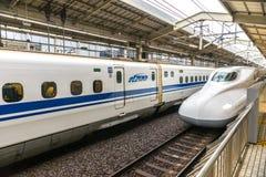 Shinkansen bullet train in Kyoto rail station, Japan. KYOTO, JAPAN - DECEMBER 04, 2014: A Shinkansen Bullet Train December 04, 2014 in Kyoto, Japan. The Stock Photos