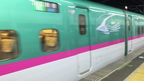 Shinkansen coming to the train station in Nagoya, Japan. The Shinkansen coming to the train station in Nagoya, Japan stock footage