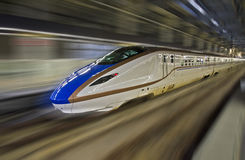 Shinkansen high-speed bullet train with motion blur. Stock Image