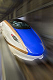 Shinkansen high-speed bullet train with motion blur. Stock Photography