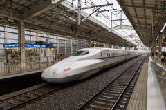 Shinkansen High Speed Train. Kyoto, Japan - December 16, 2014: A Shinkansen high speed train arriving at the train station Stock Photography