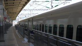 Shinkansen, Japanese bullet train, departs Odawara station. Kanagawa,Japan-July 10,2017:Shinkansen Kodama, Japanese bullet train, departs Odawara station stock footage