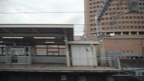 Shinkansen or a Japanese bullet train, Hikari passes Hamamatsu station. Shizuoka, Japan-May 20, 2018: shinkansen or a Japanese bullet train, Hikari, passes stock video