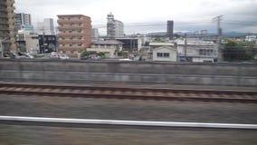 Shinkansen or a Japanese bullet train, Hikari passes Kakegawa station. Shizuoka,Japan-May 20,2018: shinkansen or a Japanese bullet train, Hikari, passes Kakegawa stock footage