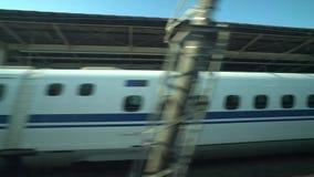 Shinkansen or a Japanese bullet train, Hikari, passes Kakegawa station. Shizuoka,Japan-May 14,2018: shinkansen or a Japanese bullet train, Hikari, passes stock video footage