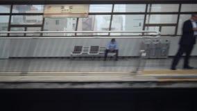 Shinkansen, Japanese bullet train, passes Hamamatsu station. Shizuoka,Japan-July 5,2017:Shinkansen, Japanese bullet train, passes Hamamatsu station. Estimated stock video footage