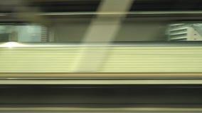Shinkansen, Japanese bullet train, passes Mikawa-anjou station. Aichi,Japan-July 7,2017:Shinkansen, Japanese bullet train, passes Mikawa-anjou station. Estimated stock video footage