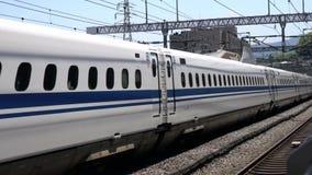 Shinkansen, Japanese bullet train, passes Odawara station. Kanagawa,Japan-July 10,2017:Shinkansen, Japanese bullet train, passes Odawara station at around 250km stock footage