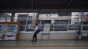 Shinkansen, Japanese bullet train, passes Toyohashi station. Aichi,Japan-July 5,2017:Shinkansen, Japanese bullet train, passes Aichi station. Estimated speed is stock footage
