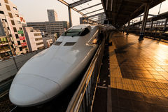 Shinkansen at Okayama Station. Okayama, Japan - November 11, 2010: A 700 series Shinkansen 'bullet train' arrives at Okayama station stock image