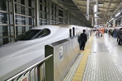 Shinkansen train, Kyoto. KYOTO, JAPAN - NOVEMBER 28, 2016: Passengers board Shinkansen train in Kyoto Station, Japan. Shinkansen bullet trains are operated by Royalty Free Stock Image
