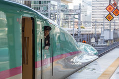 Shinkansen train operator looking out of the window Royalty Free Stock Photos