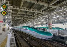 Shinkansen train stopping at railway station royalty free stock photo