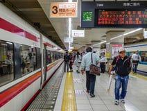Shinkansen train stopping at railway station royalty free stock photo