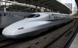 Shinkansen train streatches along track Royalty Free Stock Image