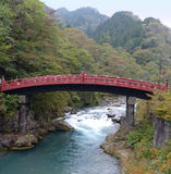 Shinkyo Bridge, Nikko. This distinctive red bridge over the River Daiya is something of a symbol for Nikko and is the oldest bridge built over a gorge in Japan Royalty Free Stock Images