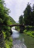 Shinkyo (Sacred Bridge) at Nikko, Japan. With mountains and river Royalty Free Stock Image